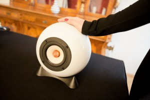 Womens hand touching ball speaker white made from Augarten Vienna porcelain.