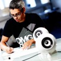 Ronald Jaklitsch, designing his innovation the white ballshaped porcelain speaker.